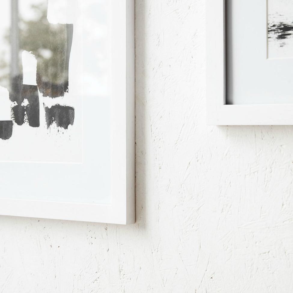 tavlor med vit ram